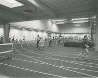 Students running and exercising in Myers Field House, Mankato State University, 1980s.