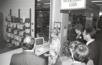 Mankato State University, Memorial Library worker, Donna Webb, giving computer demonstration, 1980?
