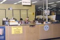 Mankato State University Memorial Library reference services desk, 1980?