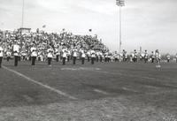 Mankato State University, college marching band performing at the homecoming football game, 1988