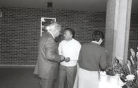 Minnesota State University, three individuals helping themselves to the food trays in the Performing Arts Building, 1988