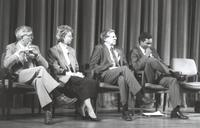 Mankato State University, four individuals (one being Micheal Fagin) sitting on stage at the Performing Art building, 1980