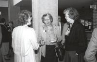 Mankato State University, former president of Margaret Preska having a conversation with two individuals in the Performing Arts Building, 1980