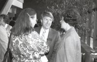 Mankato State University, Robert Beagle, speaking with two individuals at the Performing Arts Building, 1990