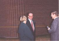 Mankato State University, three individuals talking after Hillary Clinton gave her speech. October 30, 1992