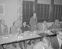 Dr. Raymond Cherry and his wife at a banquet table at the Industrial Arts Convention at Mankato State College,1958-04-08.
