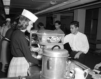 Students at Mankato State College in line at the cafeteria, 1958-03-31.