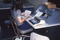 Mankato State University, student working on a typing project, 1980