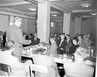 Students and faculty members in the dining hall while having a meeting at Mankato State College, 1958-03-20.