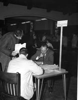 Two students meeting with an advisor at Mankato State College, 1959-12-17.
