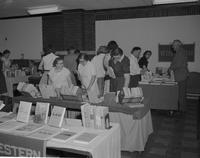 Students and faculty browsing at books at Mankato State College 1958-06-21