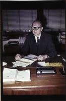 Mankato State College, former MSC president James Nickerson sitting at his desk, June 20, 1968