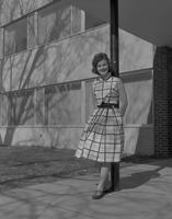 Grose, Lois  leaning against post in front of the library at Mankato State College 1959-04-28
