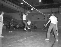 Men playing volleyball at Mankato State College 1959-11-20