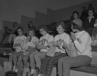 Women eating at picnic in gym at Mankato State College, 1959-09-22.