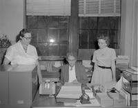 Females looking over paper work at Mankato State College 1959-01-09