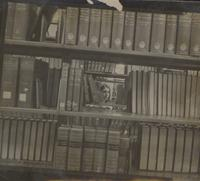 Female student hiding among library selves at Mankato State College 1959-03-01