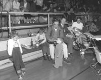 Families at All-College picnic in gym at Mankato State College, 1959-10-14.