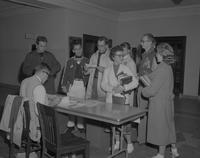 Faculty helping students with getting textbooks at Mankato State College, 1959-10-22.