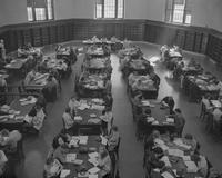 College students studying in the Lincoln library at Mankato State College, 1959-10-29.