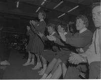 Cheerleaders at a basketball game at Mankato State College, 1964-02-25.