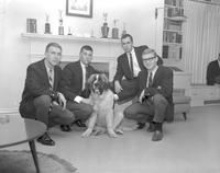 Members of Alpha Beta Mu at ABM house with dog, at Mankato State College 1964-03-02
