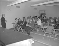 Men and women in in class at Mankato State College, 1964-03-13.