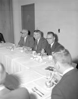 Clearance L. Crawford and others eating at Mankato State College, 1964-04-28.