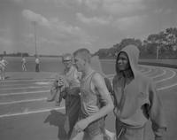Gary Draheim with Roepke and Hill during a Track and Field event at Mankato State College, 1964-06-01.
