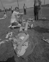 A student athlete lays in the grass, Mankato State College, 1964-06-04.