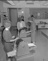 Students working with duplicating machines at Mankato State College, 1962-01-22.
