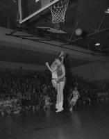 Two Basketball players from MNSU, and MSU Moorehead, jumping in the air,  Mankato State College,1962-01-22.