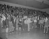 Spectators giving a standing ovation at Mankato State College, 1962-01-22.