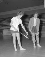 Two girls play badminton, Mankato State College, 1962-01-22.