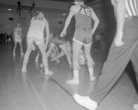 Six male Basketball players in action during a Basketball Game Event, Mankato State College, 1962-01-22.