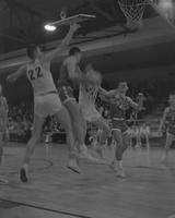 Male basketball players in action during a Basketball Game at Mankato State College, 1962-01-22.