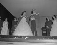 "Carole Abbey standing on stage with ""proxy king"" immediately after coronation at Mankato State College,1962-01-26."