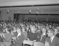 Crowd laughing and clapping during Tall Tale Contest at Mankato State College, 1962-01-26.