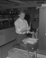 Shot of Larry Krohn working in the chem lab for Katonian's who's who section at Mankato State College, 1962-03-28.