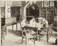 Three female students studying in the library, Mankato State Normal School, 1916.