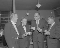 Dr. Rolf Scheurer speaking with guests after Mankato Symphony Orchestra concert at Mankato State College, 1962-11-26.