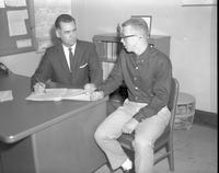 M.A. Freeman counseling a student at Mankato State College, 1962-12-11.