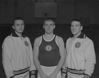 Gary Schiller, Doug Bloedel, and Gail Peterson of the gymnastic's team at Mankato State College, 1962-12-18.
