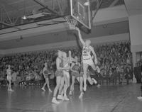 MSC Basketball player throwing the ball to the loop at Mankato State College,1962-01-07.