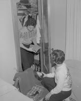 Two female students arranging a closet at Mankato State College, 1962-12-11.