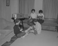 Four ladies spending time together in the living room at Mankato State College, 1962-12-11.
