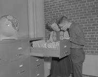 A man and woman looking at files at Mankato State College, 1962-01-07.