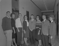 Four women and four men at Mankato State College, 1963-01-16.