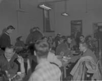 Men sitting in a crowded room at Mankato State College, 1963-01-16.