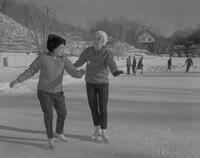 Two women ice skating at Mankato State College, 1963-01-16.